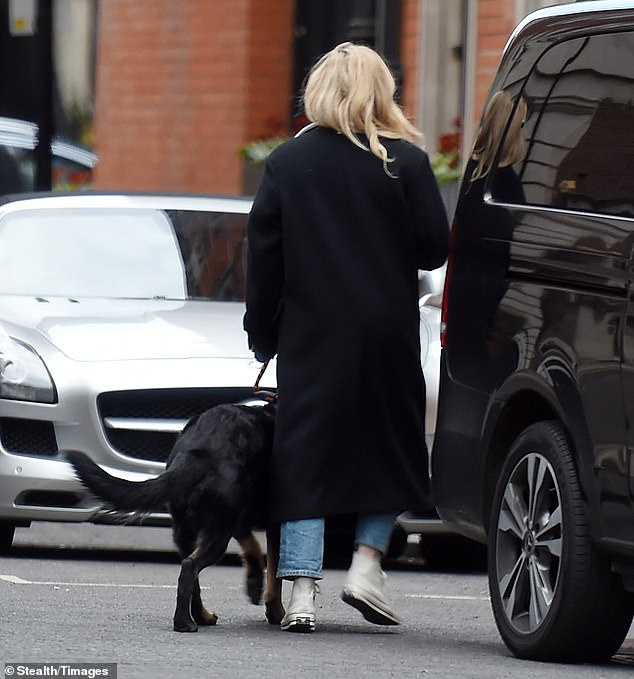 Mystery:The pair chatted for some time as her dog eagerly watched the gentleman