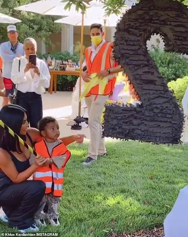 Special day: Kardashian then shared a video of Psalm being shown how to hit a pinata by his mother Kim