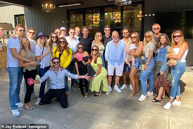 Happy days: Tamara and her husband Jay Rutland posed for a group photo as they joined friends and family to celebrate the 38th birthday of Petra Ecclestone's fiancé, Sam Palmer, earlier this month