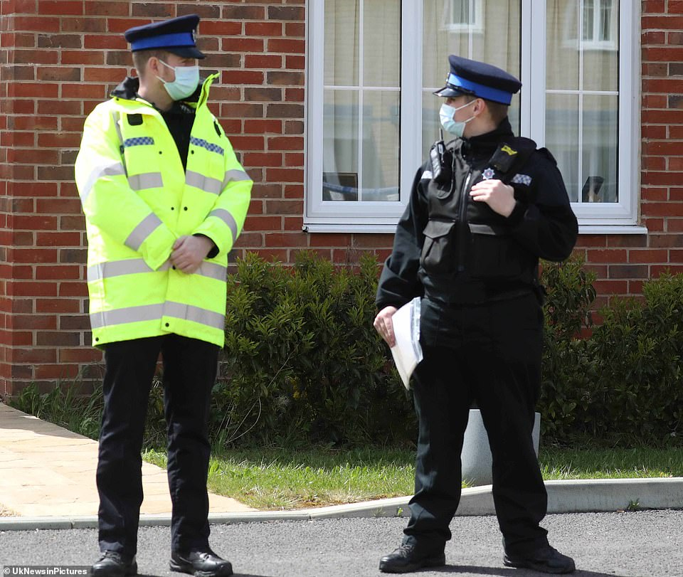 Police taped off the house in Aylesham as forensic officers conducted searches. Two officers stood outside the detached property on a new build housing estate on the outskirts of the village