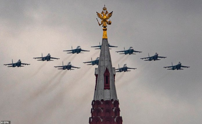 Russian Sukhoi Su-34 all-weather medium-range supersonic fighter-bomber jets, Su-30SM multirole fighter jets and SU-35S air defense fighters fly over
