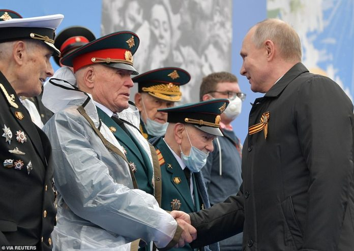 Russian President Vladimir Putin greets veterans before a Victory Day military parade, which marks the 76th anniversary of the victory over Nazi Germany in World War II, in Red Square in central Moscow