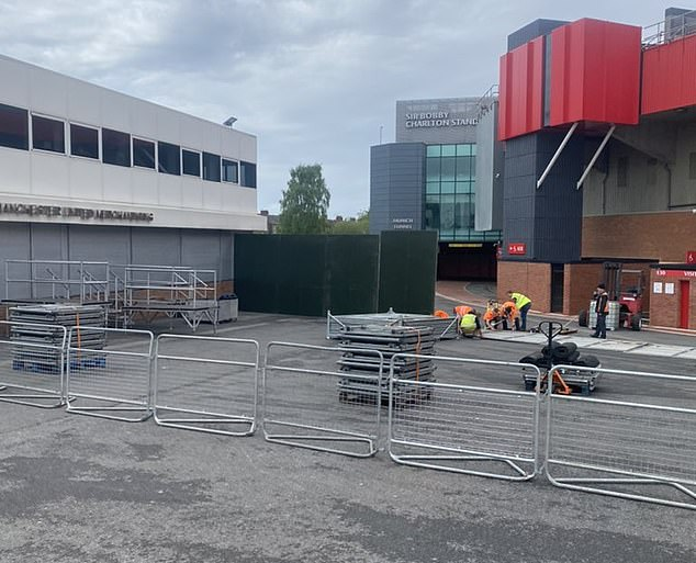 The pictures on Twitter showed staff next to barriers in front of the Sir Bobby Charlton Stand