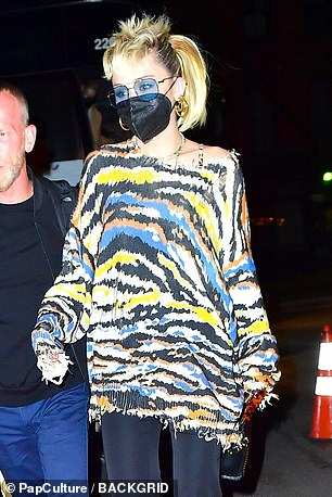 Incoming: Miley Cyrus joined the party on Saturday night as Elon Musk celebrated his hosting debut on Saturday night with girlfriend Grimes