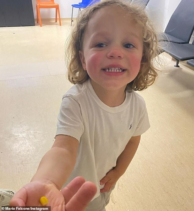 Hospital: Mario shared a photo of Parker holding the piece of sweetcorn in his hand and smiling for the camera in the hospital waiting room