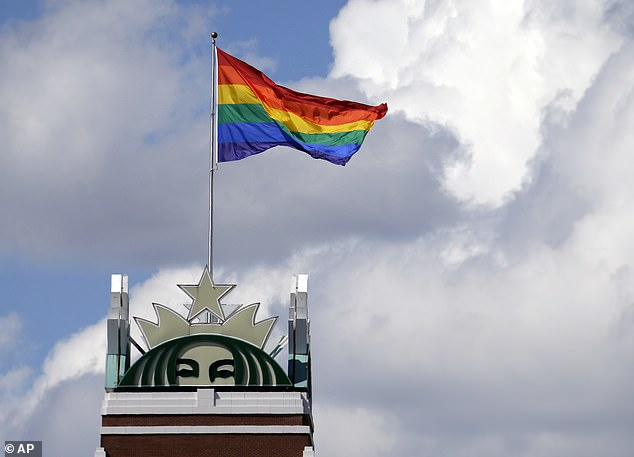 A giant pride flag flies above Starbucks headquarters in Seattle in June 2014