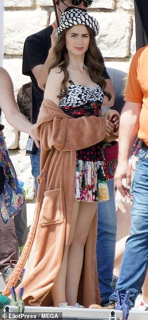 Don't Bother: Sporting a light floral minidress, the daughter actress of Genesis star Phil Collins was in high spirits as she was prepped for her next scene by a group of assistants.