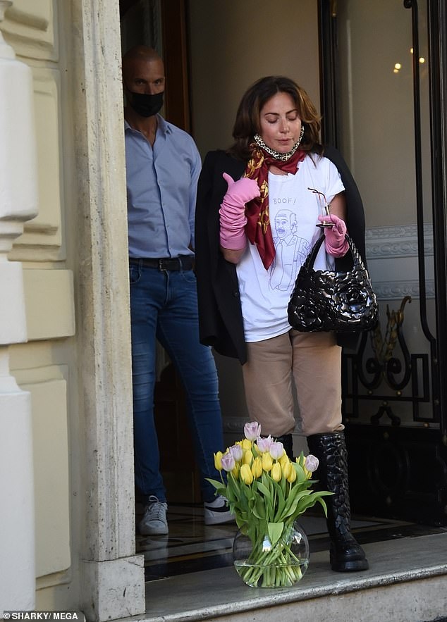 Casual: She made sure to dress comfortably for her departure in a white t-shirt and beige pants, completing her look with knee-high boots
