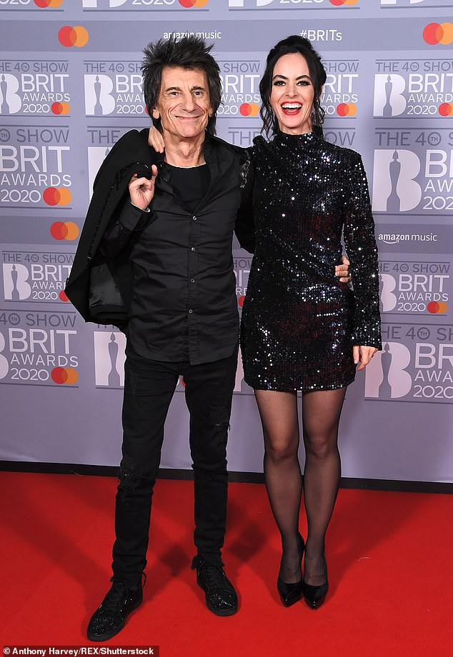 Strong couple:The actress, 43, also praised the Rolling Stones guitarist, saying he has 'incredible strength and determination' (pictured together in February 2020)