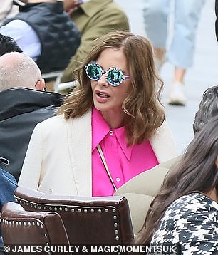 Fashion-forward: Trinny donned a chic pair of pink striped sweatpants while enjoying the sunny weather and staying comfortable in a pair of plush white sneakers
