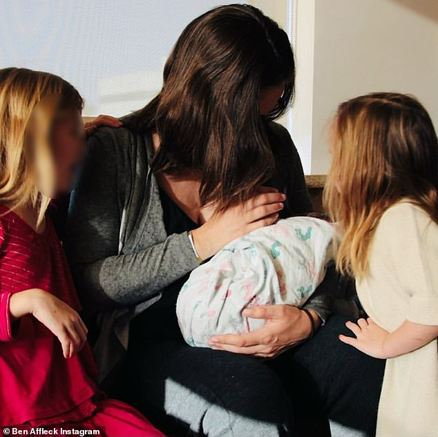 Mommy and me: The actress fawned over Samuel as her daughters watched on