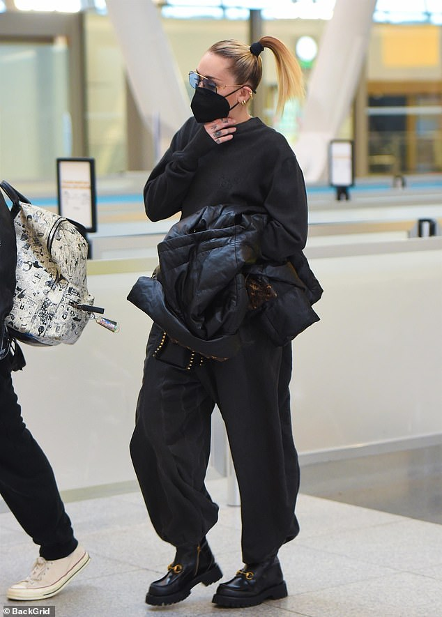 Later: She was seen heading to a plane at JFK International Airport