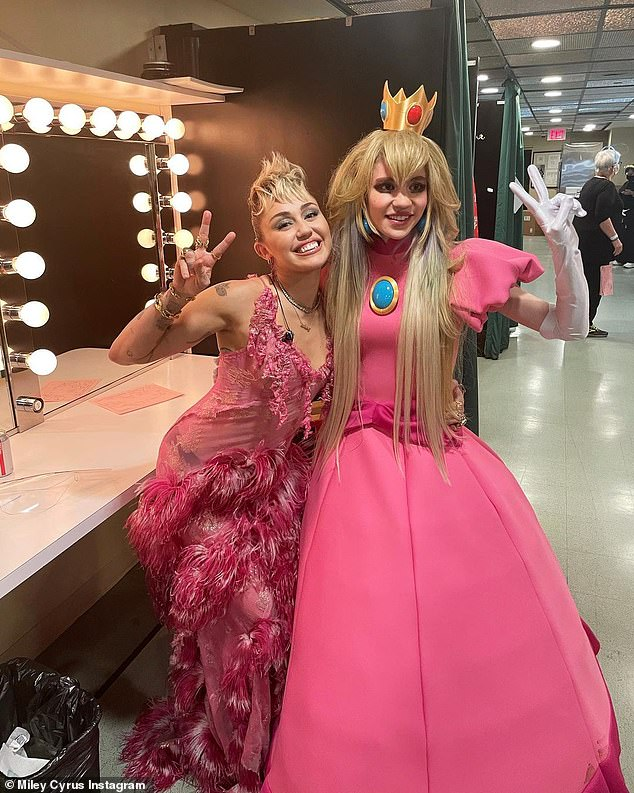 From Studio 8H: Miley posted a picture of herself with ethereal California hitmaker Grimes, wearing pink-hued getups from the SNL taping