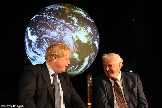 Prime Minister Boris Johnson (pictured left with Attenborough in February 2020) said there was 'no better person to build momentum for further change' than Attenborough [File photo]