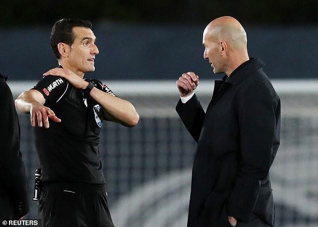 Real Madrid Head Coach Zinedine Zidane asks the referee for clarity on the handball decision