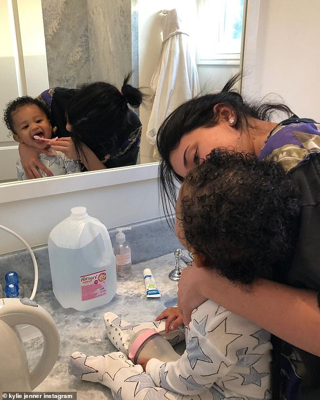 'I love being your mommy,' the Keeping Up With The Kardashians star captioned her tribute, which showed her brushing her tot's teeth and at a backyard photo shoot