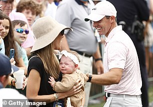 Doting father: In a bid to settle his little girl, Rory placed a protective hand on Poppy's head while Erica appeared to speak gently to the tot