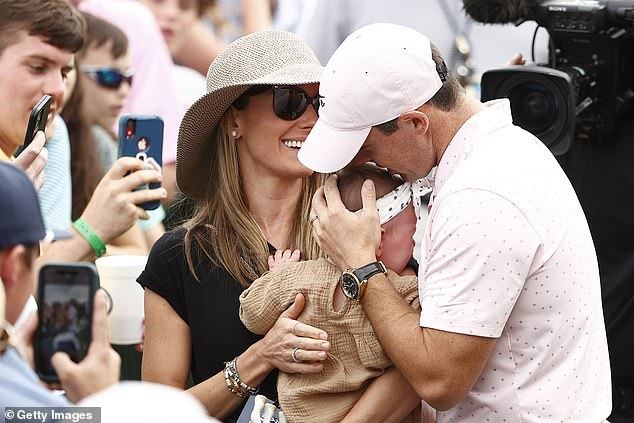 Oh dear:As the family celebrated the achievement with a hug, Poppy burst into tears as the crowds likely made lots of noise behind her