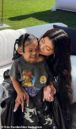 Doting moms: A second featured youngest sister Kylie, 23, sitting with daughter Stormi, also three