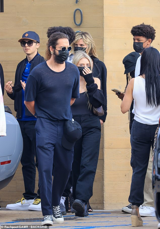 Behind Tom Kaulitz in the center:Leni, which is short for Helene, was fabulous in her own black ensemble, which featured an off-the-shoulder top and tailored pants