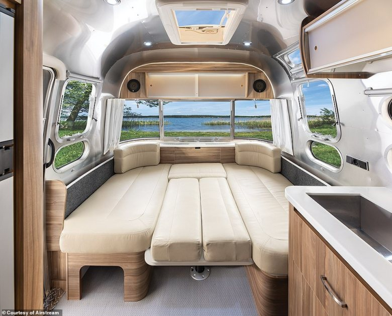Standout features of the newAirstream 25iB include leather upholstery and a retractable bed (pictured)