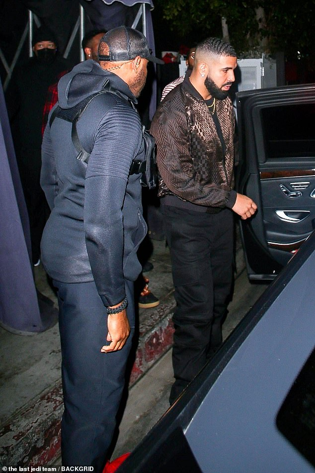 Stepping out: The rapper, 34, cut a typically suave figure in a patterned brown jacket as he left The Nice Guy in West Hollywood flanked by his security team