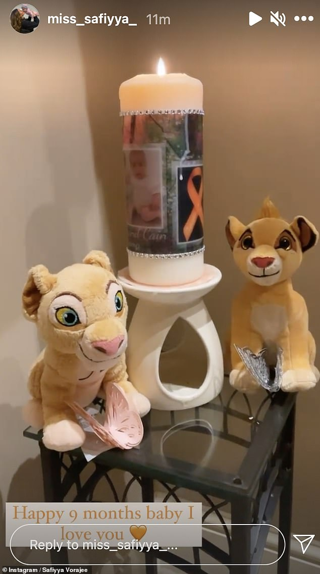 Grieving:The doting mum then shared a picture of a personalised candle burning next to two plush Lion King teddies as she wrote: 'Happy 9 months baby. I love you'