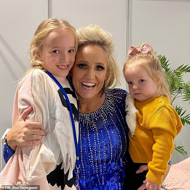 Reflecting: The radio host shared pictures of herself with her girls on set and wrote: 'It was so special to go back in time and re-do something I did before I had babies and get to share it with my girls'