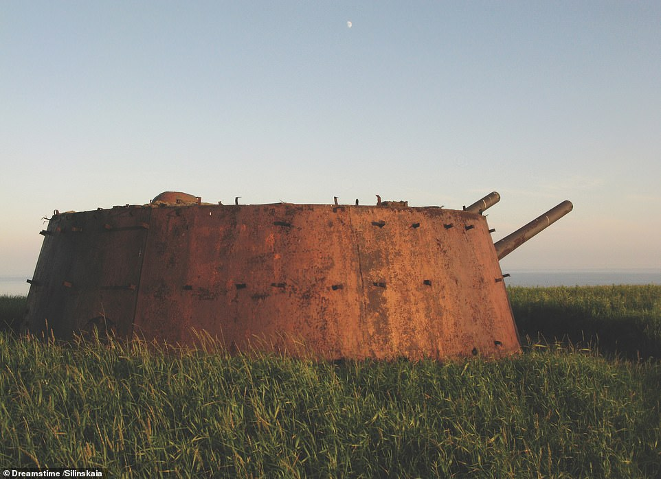 COASTAL ARTILLERY, ASKOLD, FOKINO TERRITORY, RUSSIA: Askold is an island in Peter the Great Bay of the Sea of Japan, 50km (31 miles) southeast of Vladivostok city. The book states: 'Between 1936 and 1939, the island was heavily armed with coastal batteries, including these turreted twin 180mm (7.1in) MB-2-180 guns, which were trained over the entrance of Ussuri Bay and approaches to Strelok Bay and Vostok Bay. The gun positions seen here sit atop underground towers, each containing working compartments, ammunition stores, reloading facilities and crew quarters. Each gun position was connected to its neighbour by underground passageways, totalling nearly one kilometre (0.6 miles) in length. Today, the isolated location of Askold means that the batteries are reasonably well preserved'