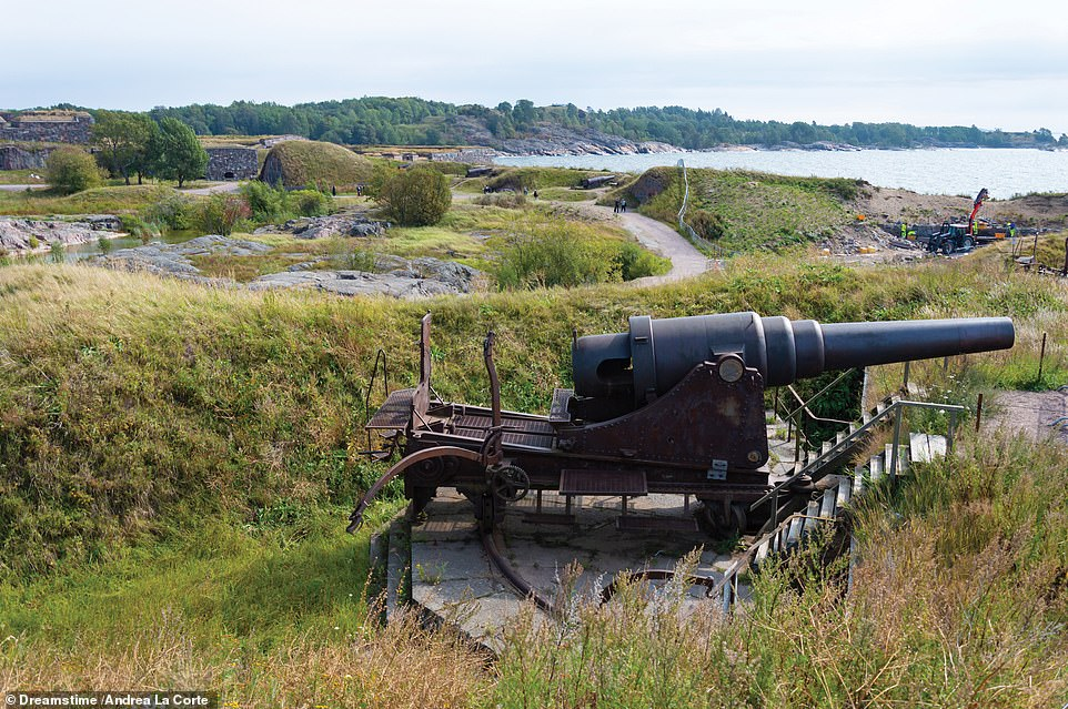 A 228MM (9IN) GUN, SUOMENLINNA FORTRESS, HELSINKI, FINLAND: According to the book, construction on the Suomenlinna ('Castle of Finland') Fortress began in 1748 and continued off and on until the 1970s, when it was handed over to civilian administration. It adds: 'Such is the extent and continuing power of the fortifications that they were added to Unesco's World Heritage List in 1991. The powerful nine-inch (228mm) gun seen here, set on a gliding mount, was one of several heavy-calibre weapons emplaced in the late 19th century, but which continued to serve during World War II, when the fortress was a base for the Finnish submarine fleet'