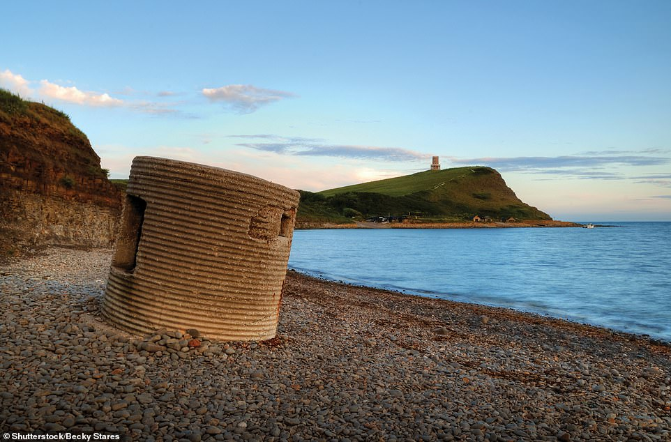 PILLBOX, KIMMERIDGE ISLAND, ISLE OF PURBECK, DORSET: 'This abandoned pillbox, tilted crazily by time, was one of thousands emplaced around the British coastline in 1940,' explains McNab. 'It is a circular Type 25 pillbox, which featured an entrance at the back (visible here) and three embrasures for rifles or light machine guns'