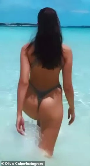 Easy life: She seemed to reveal in her vacation as she walked into the water
