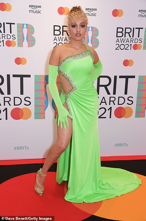 Strike a pose: Singer Mabel, 25, wowed in a vibrant neon green silk cut-out Tony Ward Couture gown