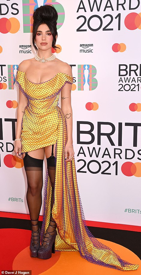 Wow: Dua, who is nominated for three awards, wowed in a tiny yellow mini Vivienne Westwood Couture corset dress