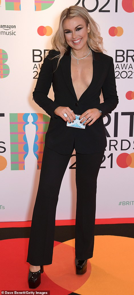 Racy: Tallia Storm looked sensational as she went braless underneath a plunging black blazer and matching trouser combo