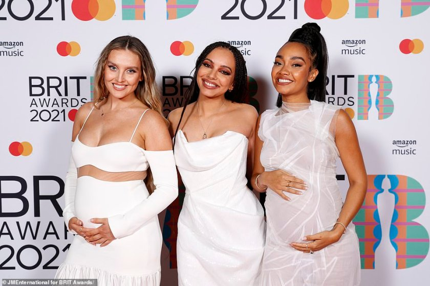 Radiant:Elsewhere, Little Mix's Perrie, 26, left, and Leigh-Anne, 29, right, looked radiant as they both cradled their bumps after announcing they were pregnant, they walked the red carpet with their bandmate Jade, 28, centre