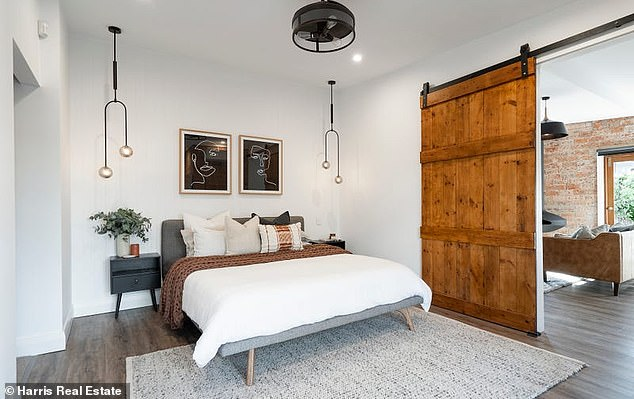Divine:Guests are welcomed into the bedrooms underneath a skylight, with built-in wardrobes and exposed brick walls to match the feel of the lounge