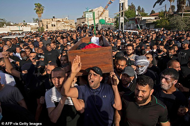 Thousands took part in the funeral, and police said the crowd set fire to a patrol car, a bus and a motorcycle. Two police officers were injured