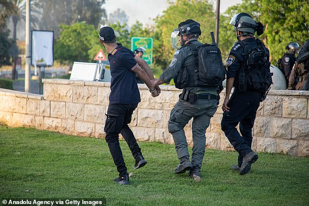 The fighting has spilled over into Israel's Arab sector, with protests taking place in dozens of communities across the country. Pictured: Lod on Tuesday