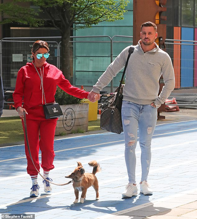 Here they come:Earlier that day Katie was hand in hand with Carl as she arrived at Channel 4 studios in Leeds for another appearance on Steph's Packed Lunch