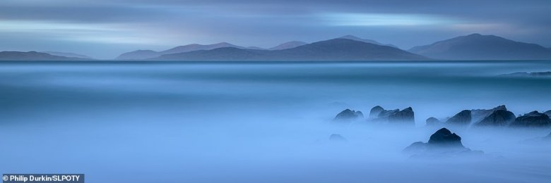 Philip Durkin took the runner-up spot in the seascape category with this mesmerising shot taken during 'blue hour' on the Isle of Harris. He explained it was taken from Bagh Steinigidh beach and visible is the island of Taransay - and 'the hills beyond'