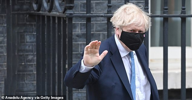 Boris Johnson, pictured in Downing Street today, is under fire after he failed to include a plan to fix the nation's social care crisis in the Queen's Speech
