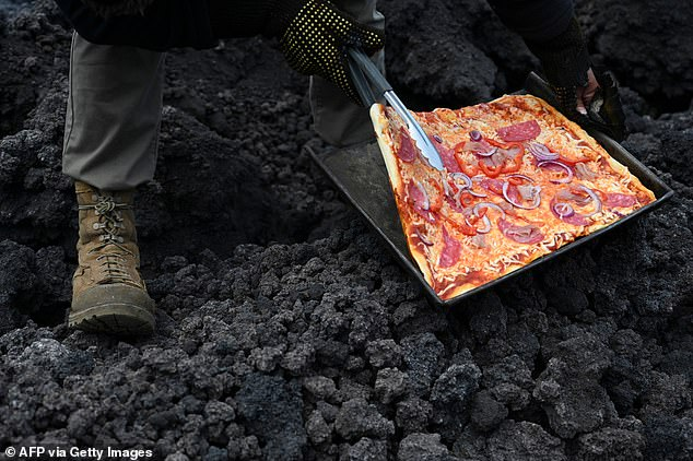 Garcia must make sure the temperature does not rise too high and burn the mussels and the dough.  And if he lays the sheet directly on a stream of lava, `` I have to make sure the pizza doesn't wander away ''
