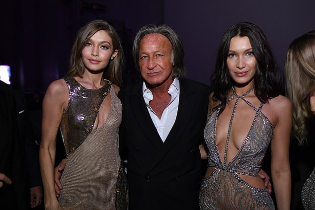 Gigi (left) and Bella are seen with their father at a Victoria's Secret party in Paris in 2016
