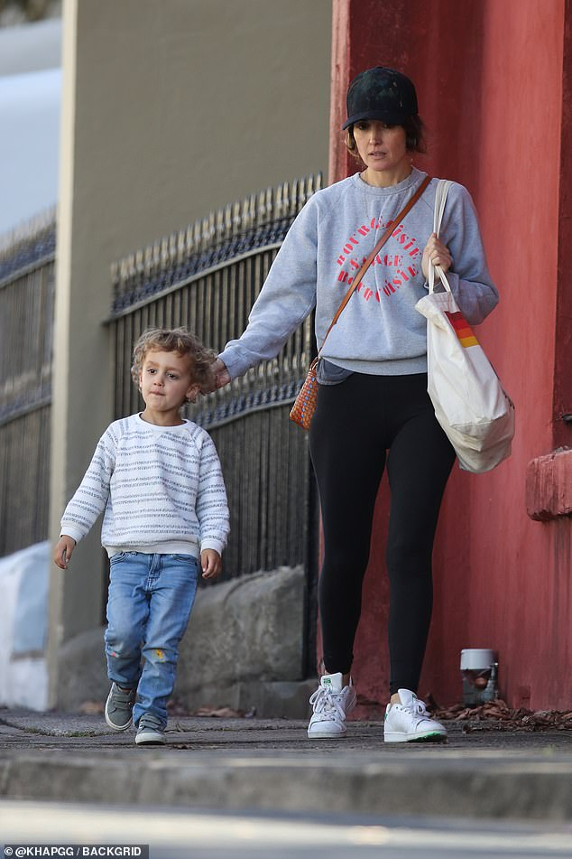 No makeup necessary: Rose Byrne [pictured] let her natural beauty shine through on Wednesday, when the Australian actress took a makeup free stroll through Sydney with her partner Bobby Cannavale and their son Rafa [L]