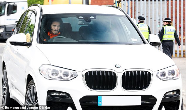 Edinson Cavani was seen in his white BMW on Thursday afternoon as he drove to the ground