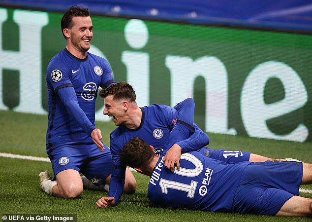 Chilwell (left) slides in to celebrate with Mason Mount and Christian Pulisic against Real