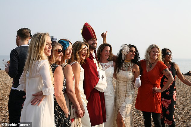 Sophie hired a popular bar on the beach for her wedding reception and had 15 bridesmaids. Pictured: Sophie's vow renewal