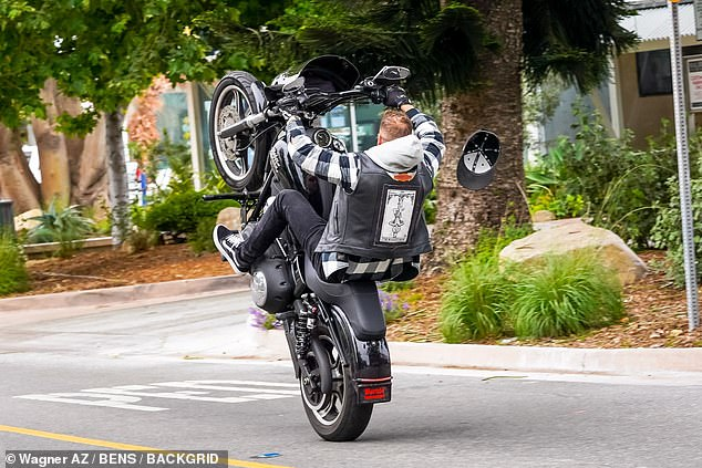 Oops! A black LA Dodgers hat Chet was wearing flipped off his head amid the wheelie