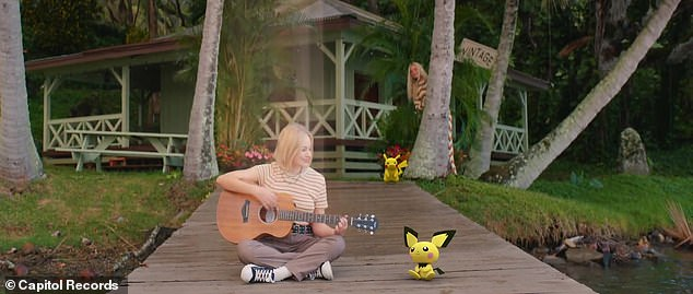 Pichu:Perry and Pikachu are seen watching a young blonde singer playing guitar with another Pokemon character, Pichu, watching and smiling